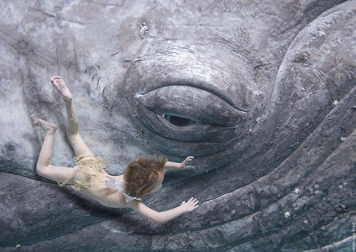 Young boy and whale calf: The Waterbabies by Charles Kingsely |
