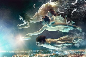 black water and a family of angels clothed in white explore an underwater city with bright twinking lights.